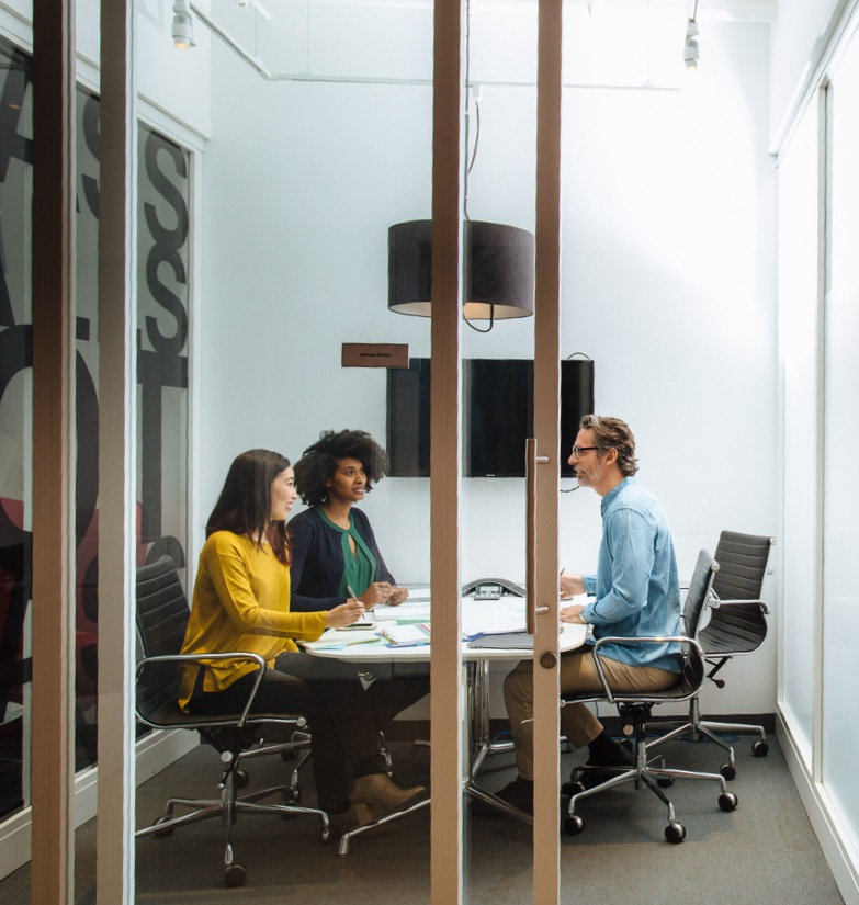 Business meeting with three persons in attendance in Flexible Office space at WorkSpace Offices.