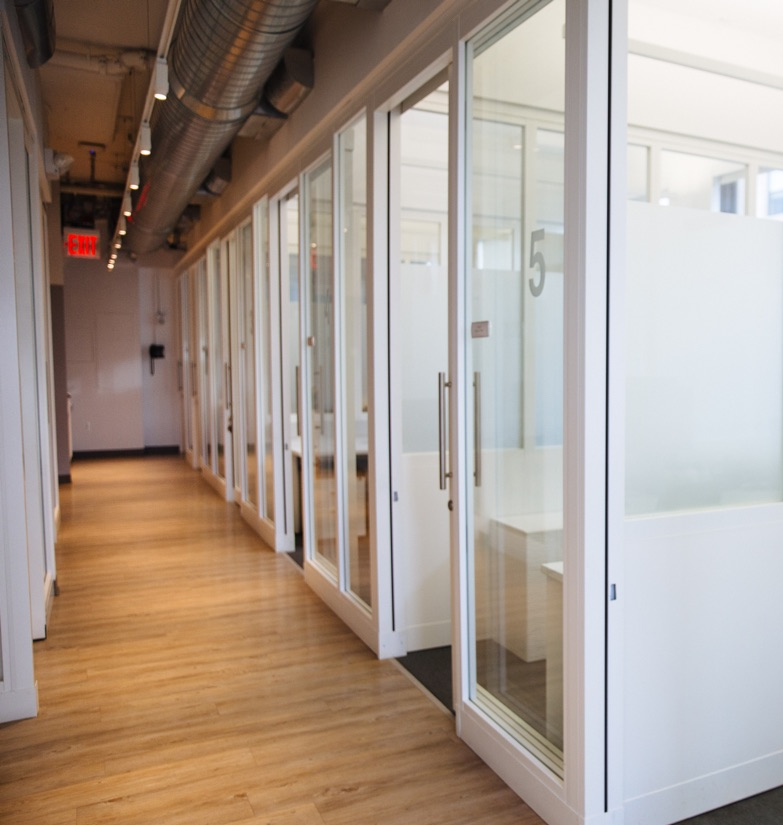 Row of Glass Flexible Office suites along hallway for rent in New York City.