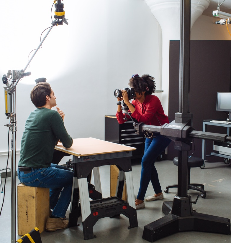 Photographer shooting subject at a small rentable studio in a WorkSpace Offices Fflexible Growth Suite in New York City.