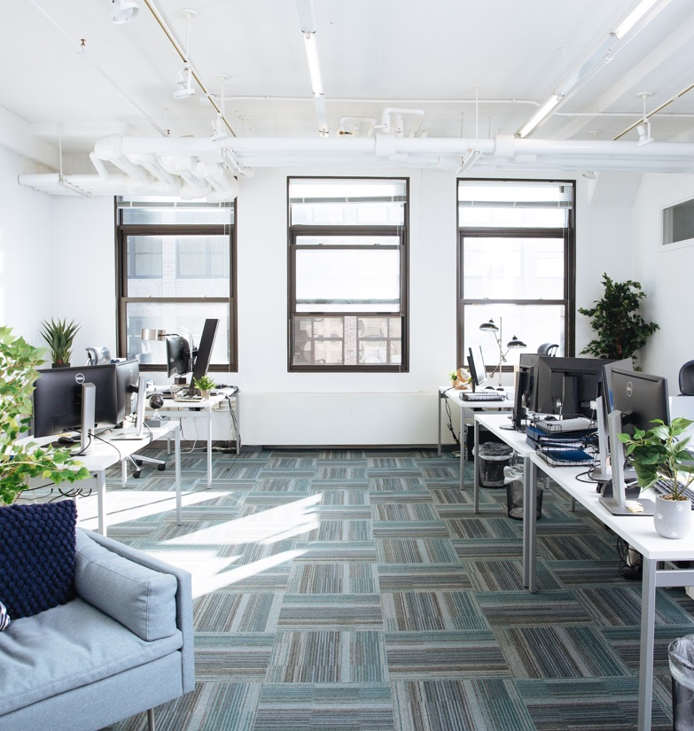 Convertible HQ Suite with individual work-stations and large ceiling-to-floor windows perfect for short-term office rental in NYC.